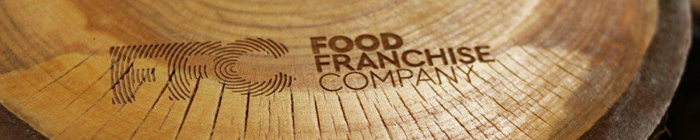 Boomstamschijven met haarscherpe gravure voor Food Franchise Company